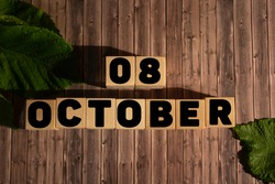 October 8.October 8 on wooden cubes on a wooden background.Autumn.Calendar for October.