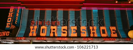 OCTOBER 2004 - Panoramic view of Horseshoe Casino and Neon sign in Las Vegas, NV