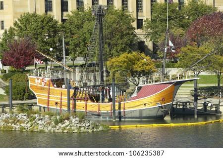 OCTOBER 2004 - Replica of Columbus' ship the Santa Maria on Scioto River, Columbus Ohio skyline in autumn