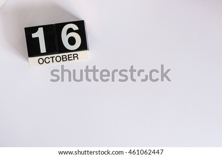 October 16th. Day 16 of month, wooden color calendar on white background. Autumn time. Empty space for text