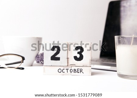 October 23th . October 23 white wooden calendar on white background. Autumn day. Copy space for your text. #1531779089