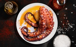 octopus dish with salt, oil and paprika