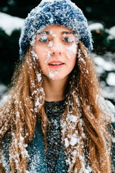 Odd foolish bizarre fun closeup portrait. Unique crazy girl. Woman snow covered face. Frozen ice female hair. Cryotherapy. Medicine and skin care. Have fun. Like child. Cold winter concept. Frostbite.