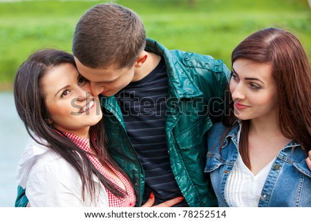 Odd man out. Young teenage couple outdoor