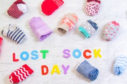Odd socks day, the day of the lost socks, many pairs of socks twisted into one another, the inscription