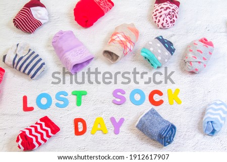 """Odd socks day, the day of the lost socks, many pairs of socks twisted into one another, the inscription """"socks""""."""