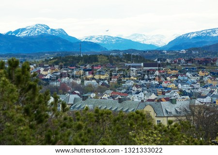 Odda is a town in Odda municipality in Hordaland county, Hardanger district in Norway. Located near Trolltunga rock formation. Panoramic photo on a sunny day in May.