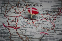 Odense pinned on a map with the flag of Denmark
