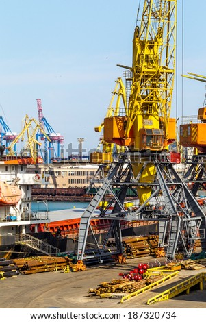 ODESSA, UKRAINE - APRIL 15: industrial  sea cargo cranes in the dock harbor of Odessa sea trading port cargo loading marine vessel in  Odessa cargo container terminal, April 15, 2014 Odessa, Ukraine