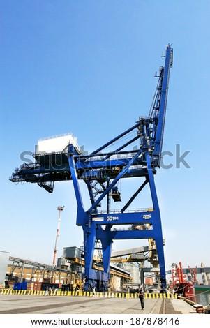 ODESSA, UKRAINE - APRIL 15: industrial sea cargo cranes on the dock harbor of Odessa Sea Commercial Port of loading in Odessa marine vessel cargo container terminal , April 15, 2014 Odessa, Ukraine