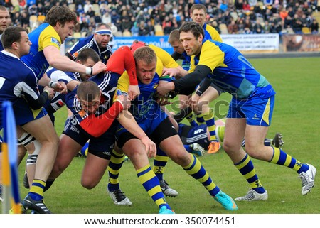 Odessa, Ukraine -7 April 2013: International European Cup rugby. Team of Moldova and Ukraine. Players jostle and fight fiercely for possession Ball. The tense battle of match