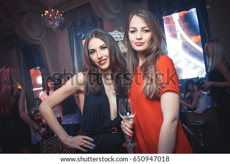 Odessa, Ukraine April 12, 2014: Ministerium night club. Girls smiling and posing on cam during concert in night club party. woman have fun at club. girl at night club party #650947018