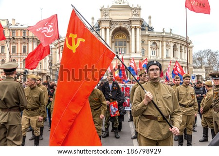 ODESSA, UKRAINE - April 10, 2014 : Victory Day World War II. Holiday parade on the streets. Flag bearer . April 10, 2014 in Odessa , Ukraine.