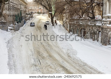 Odessa, Ukraine - December 29, 2014: Natural disasters, snow storm with heavy snow paralyzed the city. Kolaps. Snow covered the cyclone Europe, December 29, 2014 in Odessa, Ukraine. #240692575