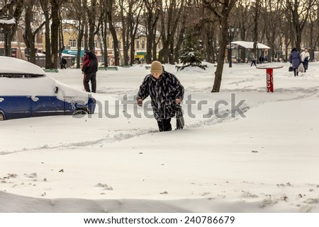 Odessa, Ukraine - December 29, 2014: Natural disasters, snow storm with heavy snow paralyzed the city. Kolaps. Snow covered the cyclone Europe, December 29, 2014 in Odessa, Ukraine. #240786679