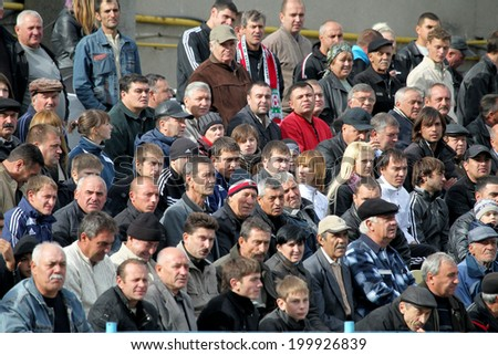 ODESSA, UKRAINE - July 10, 2013: emotional football fans support the team at the stadium during a game of football club Chernomorets, July 10, 2013, Odessa, Ukraine