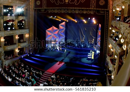 ODESSA, UKRAINE - July 21, 2012: Spectators in audience hall of viewers of Odessa State Opera and Ballet Theatre during opening of International Film Festival. Audience at concert at theater #561835210
