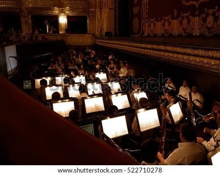 ODESSA, UKRAINE - July 6 2013: The orchestra pit with the score, notes, musical instruments and performers during the performance of choreography at the National Theatre of Opera and Ballet #522710278