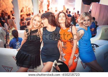 Odessa, Ukraine June 28, 2014: Ibiza night club. People smiling and posing on cam during concert in night club party. Man and woman have fun at club. Boy and girl at night club party #650218723
