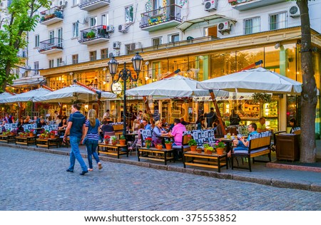 ODESSA, UKRAINE - MAY 17, 2015: The best way to relax in the evening in Odessa is to have a supper in summer terrace in on of the restaurants, on May 17 in Odessa.