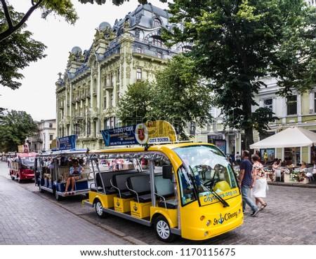 Odessa, Ukraine - Sep 2, 2018: Tourist sightseeing bus on Deribasovskaya street.