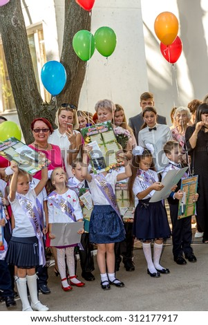 Odessa, Ukraine - September 1, 2015: primary school children with teachers and parents on the first day of the school year. Feast Day of Knowledge. Classes start the new school year.
