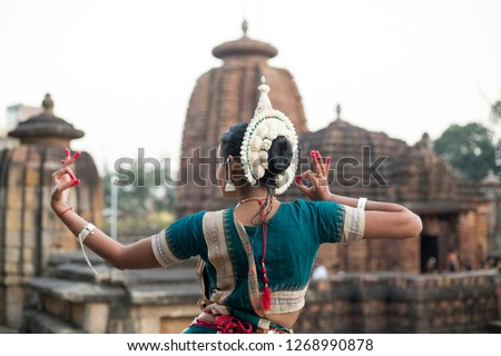 Odissi Dancer wears traditional costume with hand mudra at Mukteshvara Temple,Bhubaneswar, Odisha, India  #1268990878