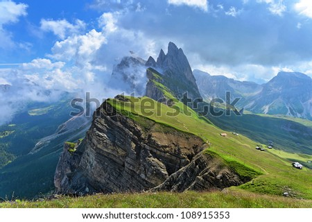 Odle mountains chain separating the  Funes valley from the Gardena valley, taken from the Seceda refuge, Italian alps