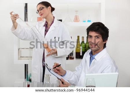 Oenologists analysing different wines - stock photo