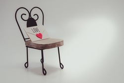 Of love letter and chairs image