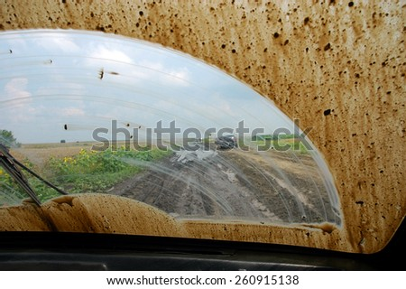 Of road driving through the mud with a dirty windshield
