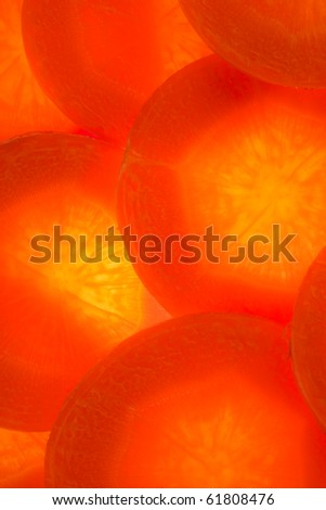 Of the circles of carrot lined background. Without gaps. Illumination from below.