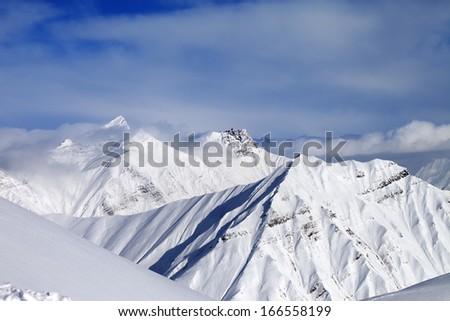 Off-piste slope and snowy mountains. Caucasus Mountains, Georgia, ski resort Gudauri. - stock photo