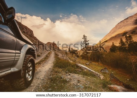 Off-road car on mountain road #317072117