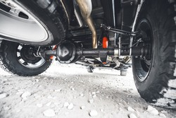 Off road car suspension. Wheel of the off-road pickup. Truck at the gravel road