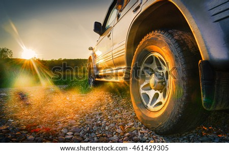 Off-road travel on mountain road. Beautiful mountains sunset #461429305