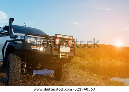 Off-road travel on mountain road. Beautiful mountains sunset with river #521948563