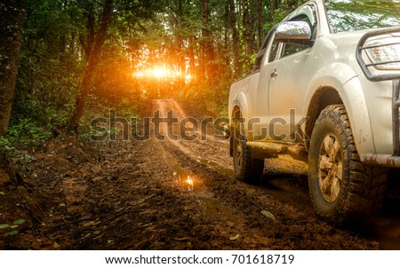 Off-road travel on mountain road. Beautiful nature sunset #701618719