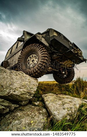 Off-road travel on mountain road. Car tire. Tire for offroad. Offroad vehicle stuck on impenetrable road after rain in the countryside Stock photo ©