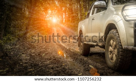 Off-road travel on mountain road, with light off sunset.