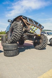 Off-road tuned car. Lift car. Large tires for the swamp