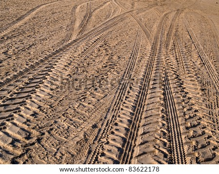 Off road 4X4 wheel tracks on country desert beach road sand motoring background image