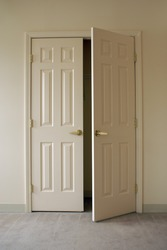off white freshly painted wall and closet doors, doors are closed