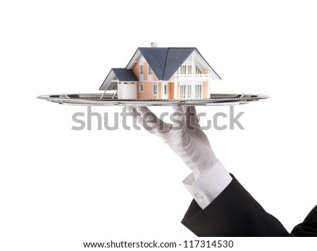 Offer of house concept (real estate). Waiter is having model of the house on tray.