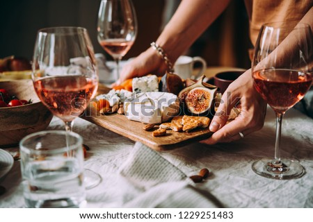 Offering appetizers at a friendly party. Dinner or aperitivo party concept. #1229251483