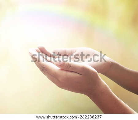 Offering concept: Human open two empty hands with palms up over blurred rainbow nature background #262238237