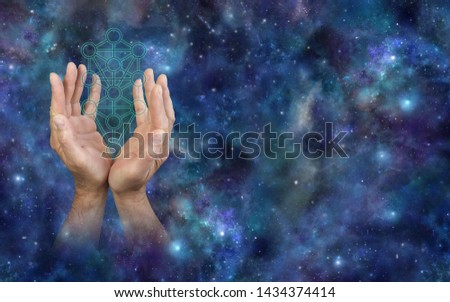 Offering the Kabbalah Tree of Life - male hands reaching up around the Kabbalah Tree of Life symbol outline against a cosmic deep space background