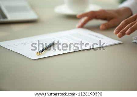 Offering to sign contract concept, businesswoman proposing reading terms conditions of business paper deal, legal sale purchase document for bank loan, insurance services or employment close up view