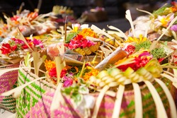Offerings to gods in Bali with flowers, food and aroma sticks