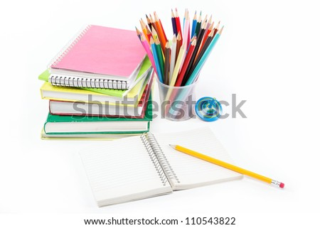 Office and school accessories. Pencil and notebook isolated on white background.